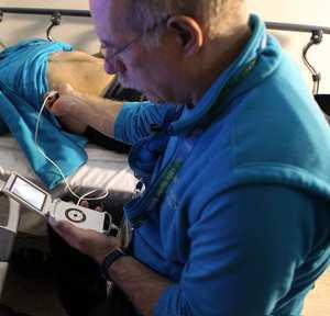 Dr Ross Brown examines a patient using a pocket-sized ultrasound at the Vancouver 2010 Winter Olympics.